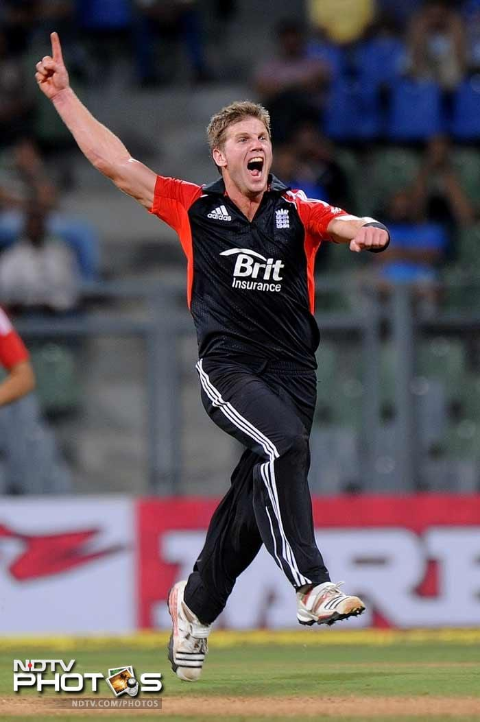 Stuart Meaker celebrates after taking the wicket of Ajinkya Rahane during the fourth One-Day International between India and England at the Wankhede stadium in Mumbai. (AFP Photo)