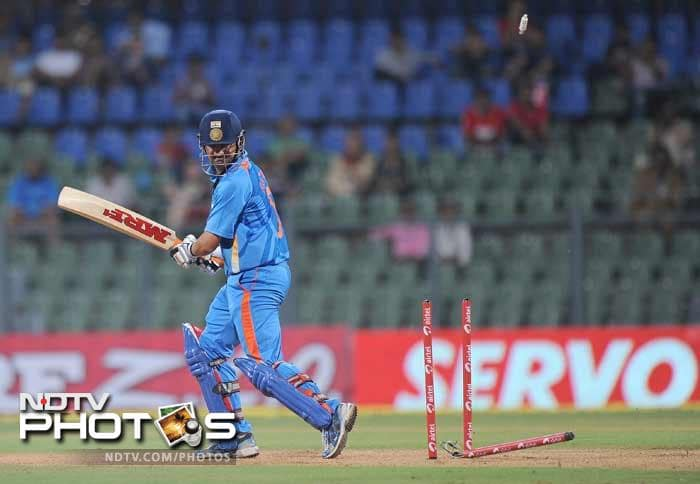 Gautam Gambhir is clean bowled during the fourth One-Day International between India and England at the Wankhede stadium in Mumbai. (AFP Photo)