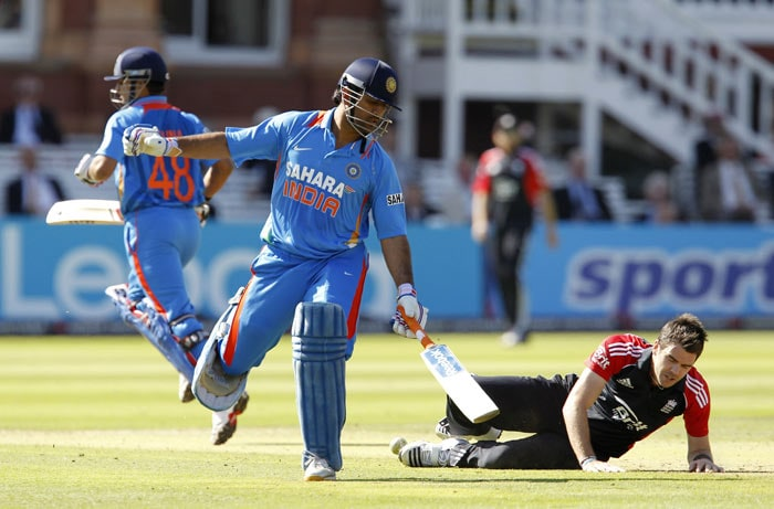 MS Dhoni collides with James Anderson whilst running between wickets during the fourth ODI between England and India at Lord's in London. (AFP Photo)