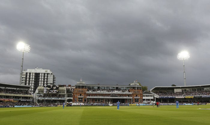 The floodlights are on as clouds cover the ground during the fourth ODI between England and India at Lord's in London. (AFP Photo)