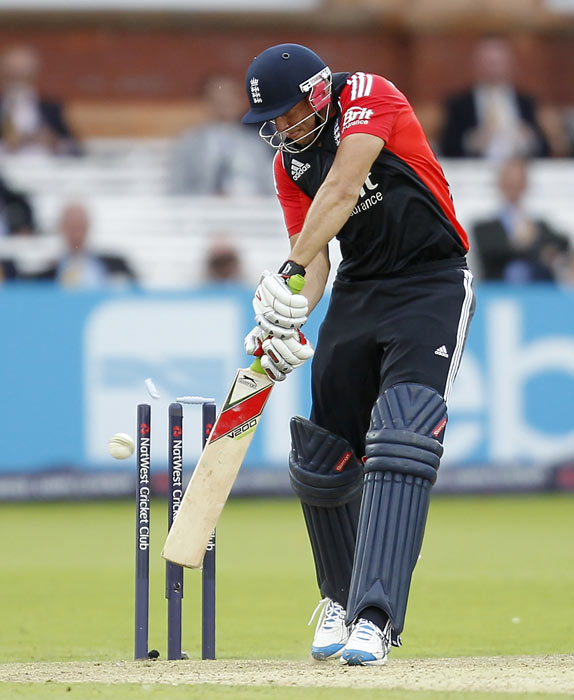 Tim Bresnan is bowled by RP Singh for 27 runs during the fourth ODI between England and India at Lord's in London. (AFP Photo)