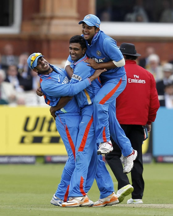 Ravichandran Ashwin celebrates taking the wicket of Ben Stokes with Suresh Raina (R) and Manoj Tiwary (L) during the fourth ODI between England and India at Lord's in London. (AFP Photo)