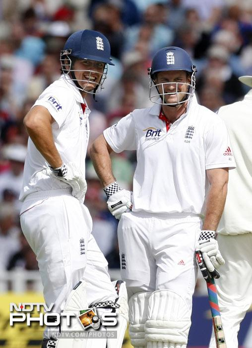 Andrew Strauss and his opening partner Alastair Cook talk between overs on the second day of the third Test match at the Edgbaston Cricket Ground, Birmingham. (AP Photo)
