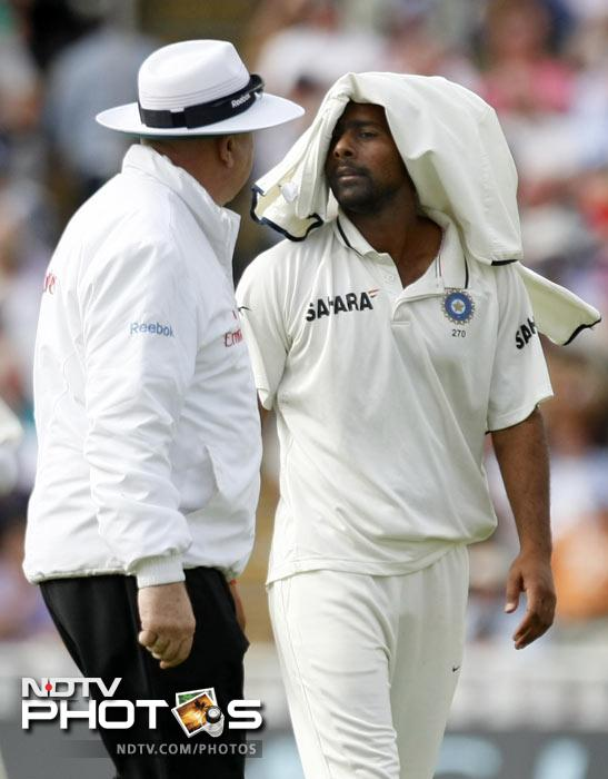 Umpire Steve Davis talks with Praveen Kumar after finishing his over on the second day of the third Test match at the Edgbaston Cricket Ground, Birmingham. (AP Photo)