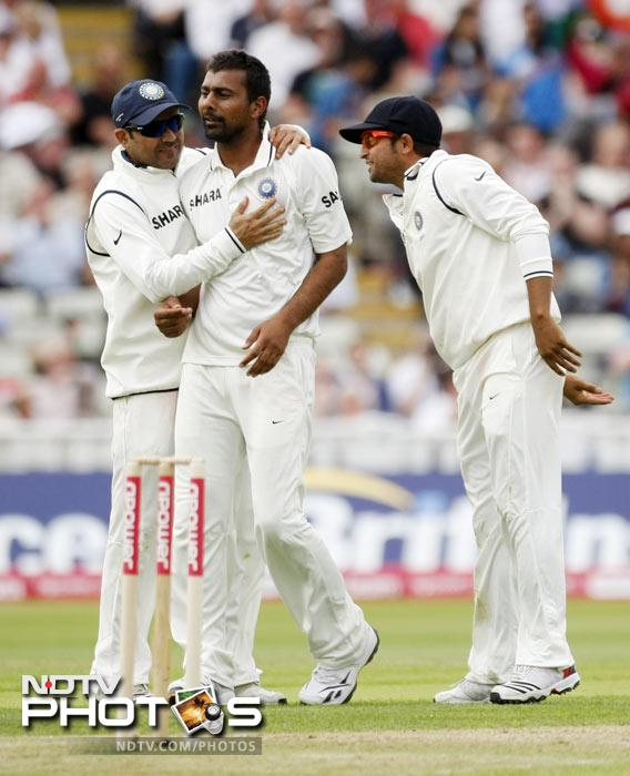 Praveen Kumar is congratulated by teammates Virender Sehwag and Suresh Raina after taking the wicket of Kevin Pietersen on the second day of the third Test match at the Edgbaston Cricket Ground, Birmingham. (AP Photo)