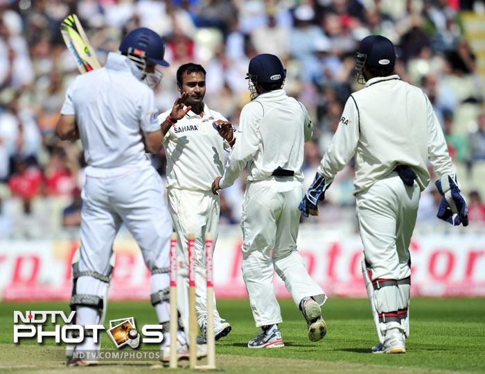 Amit Mishra celebrates bowling out Andrew Strauss for 87 during the second day of the third Test against England at the Edgbaston Cricket Ground in Birmingham. (AFP Photo)