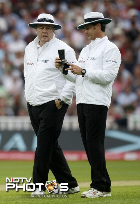 Umpires Simon Taufel and Steve Davis take a light reading on the third day of the third Test match between England and India at the Edgbaston Cricket Ground, Birmingham. (AP Photo)