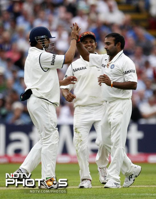 Amit Mishra is congratulated by teammates Gautam Gambhir and Suresh Raina after he took the wicket of Ravi Bopara on the third day of the third Test match at the Edgbaston Cricket Ground, Birmingham. (AP Photo)