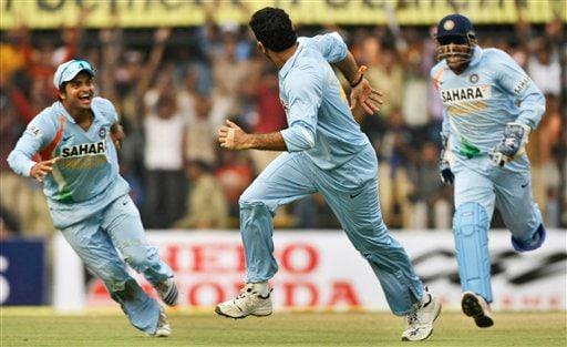 Yuvraj Singh, centre, celebrates along with Indian captain Mahendra Dhoni, right, and Suresh Raina after Yuvraj dismissed Kevin Pietersen, unseen, during the second one-day international match between India and England in Indore on Monday, November 17, 2008. India won by 54 runs.(AP Photo)