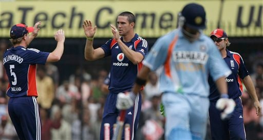 Kevin Pietersen, second left, is congratulated by Paul Collingwood, left, and Ian Bell, right, after he dismissed Indian batsman Gautam Gambhir, second right, during their second one-day international match in Indore on Monday, November 17, 2008. (AP Photo)