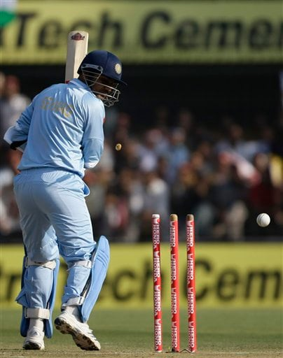 Virendra Sehwag looks back to himself clean-bowled during the second one-day international match between India and England in Indore on Monday, November 17, 2008. (AP Photo)