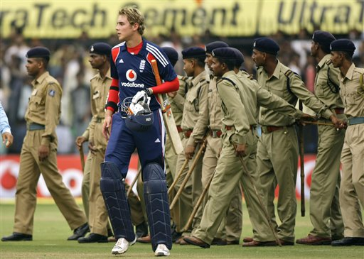 Stuart Broad leaves as security personnel enter after England lost the second one-day international cricket match between India and England in Indore on Monday, November 17, 2008. India won by 54 runs.(AP Photo)