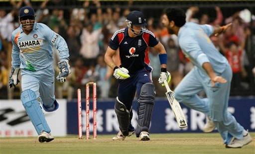 Yuvraj Singh, right, and Indian captain Mahendra Singh Dhoni, left, react after Yuvraj dismissed England captain Kevin Pietersen, centre, during their second one-day international cricket match in Indore on Monday, November 17, 2008. (AP Photo)
