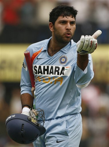 Yuvraj Singh reacts after scoring a century against England during their second one-day international cricket match in Indore on Monday, November 17, 2008. (AP Photo)