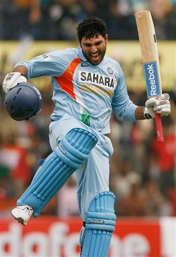 Yuvraj Singh reacts after scoring a century against England during their second one-day international match in Indore on Monday, November 17, 2008. (AP Photo)