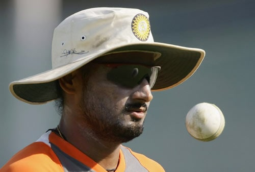 Indian bowler Harbhajan Singh plays with a ball during a practice session in Rajkot on Thursday. (AP Photo)