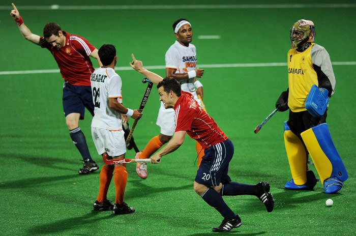 English hockey player James Tindall celebrates scoring a goal against India during their World Cup 2010 match at the Major Dhyan Chand Stadium in New Delhi. (AFP Photo)