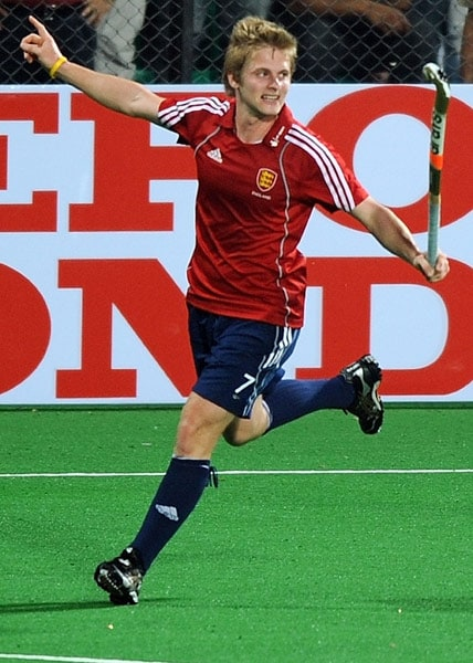 English hockey player Ashley Jackson celebrates scoring a goal against India during their World Cup 2010 match at the Major Dhyan Chand Stadium in New Delhi. (AFP Photo)