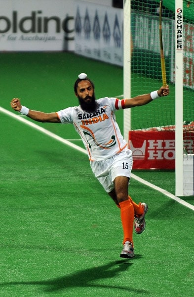 Indian hockey captain Rajpal Singh celebrates scoring a goal during their World Cup 2010 match against England at the Major Dhyan Chand Stadium in New Delhi. (AFP Photo)