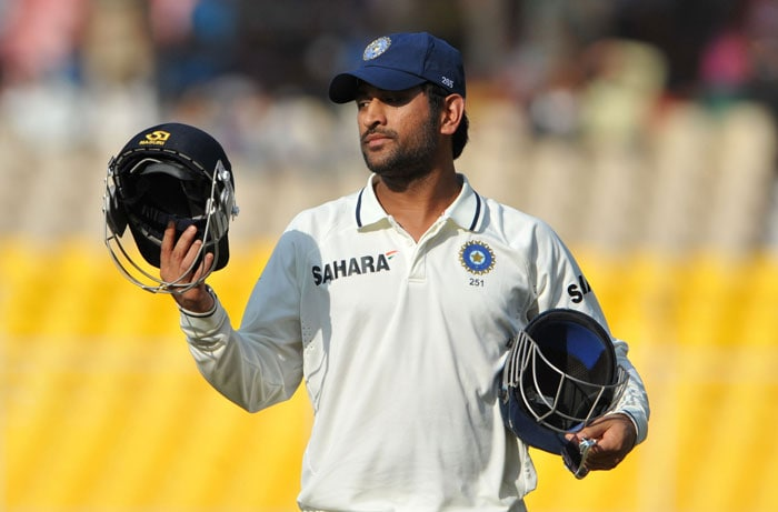 Indian captain MS Dhoni leaves the field during the final day of the first Test match between India and New Zealand at the Sardar Patel Gujarat Stadium at Motera, Ahmedabad. The first Test between India and New Zealand ended in a draw shortly after tea on the fifth and final day. (AFP Photo)