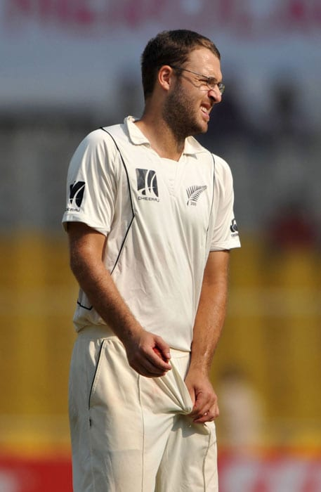 Daniel Vettori walks towards his bowling end during the fifth and final day of the first Test match between India and New Zealand in Ahmedabad. (AFP Photo)