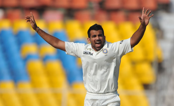 Zaheer Khan successfully appeals against New Zealand cricketer Tim McIntosh during the final day of the first Test match between India and New Zealand in Ahmedabad. (AFP Photo)
