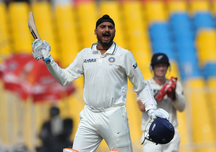 Harbhajan Singh celebrates after he completed his century during the fifth and final day of the first Test match between India and New Zealand in Ahmedabad. (AFP Photo)