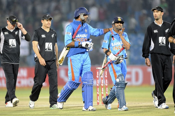 Gautam Gambhir and Yuvraj Singh celebrate their team victory during the second ODI between India and New Zealand at the Sawai Mansingh Stadium in Jaipur. India beat New Zealand by eight wickets. (AFP Photo)