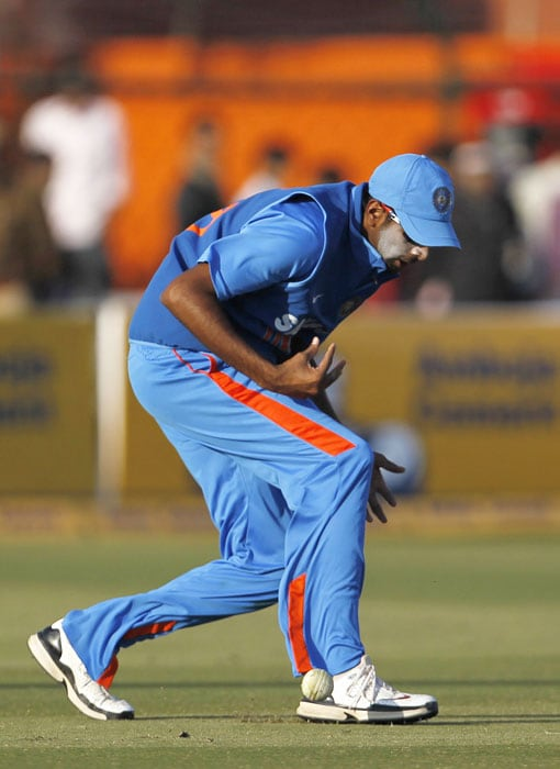 Ravichandran Ashwin lets a catch slip during the second ODI against New Zealand in Jaipur. (AP Photo)