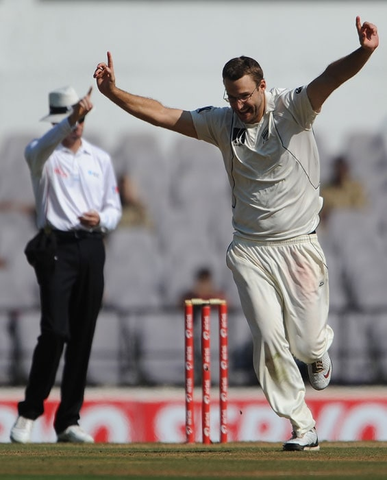Daniel Vettori celebrates after taking wicket of Suresh Raina on the third day of the third and final Test the Vidarbha Cricket Association Stadium in Nagpur. (AFP Photo)