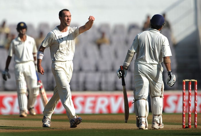 Andy McKay celebrates after taking the wicket of Sachin Tendulkar on the third day of the third and final Test the Vidarbha Cricket Association Stadium in Nagpur. (AFP Photo)