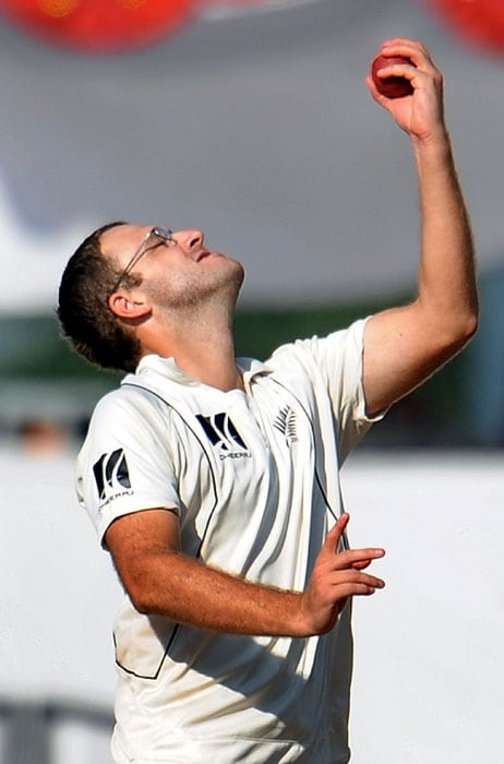 New Zealand's captain Daniel Vettori celebrates after taking the catch of India's captain Mahendra Singh Dhoni on the third day of the third and final Test against New Zealand at the Vidarbha Cricket Association, Jamtha Stadium in Nagpur. (AFP Photo)