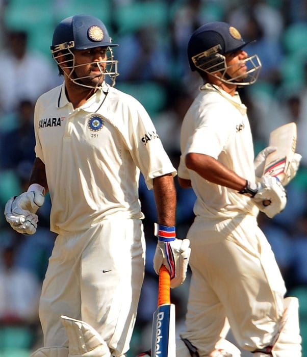 Mahendra Singh Dhoni and Rahul Dravid run between the wickets on the third day of the third and final Test against New Zealand at the Vidarbha Cricket Association, Jamtha Stadium in Nagpur. (AFP Photo)