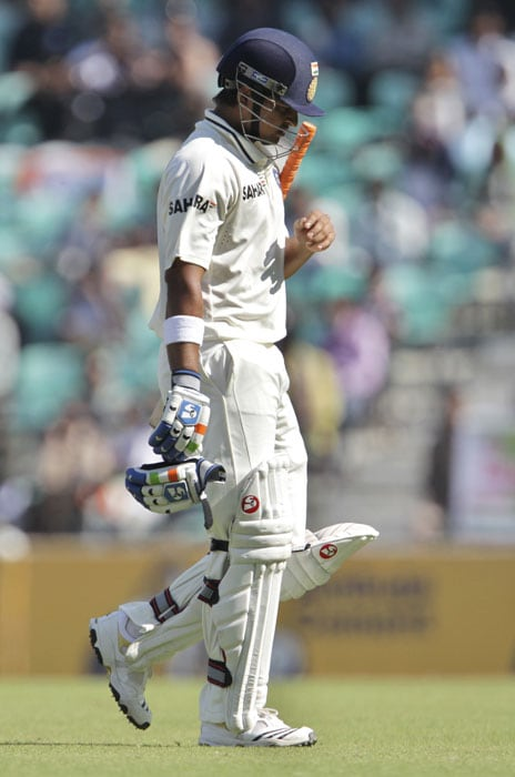 India's Suresh Raina leaves the ground after being dismissed by New Zealand's Daniel Vettori during the third day of their last Test in Nagpur. (AP Photo)