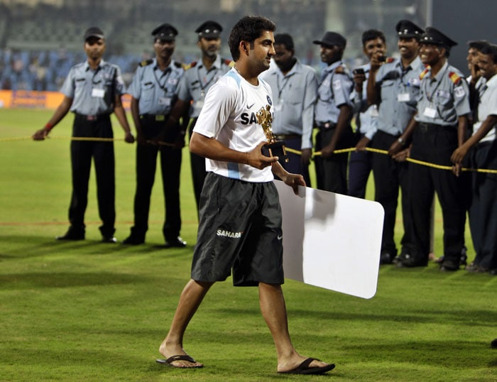 India's Gautam Gambhir walks with his Man of the Series trophy after their win over New Zealand in the last ODI in Chennai. (AP Photo)