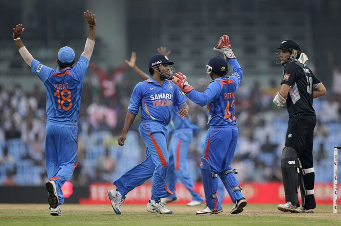 Indian cricketers celebrate the dismissal of Tim Southee the last wicket of New Zealand innings during their last ODI in Chennai. (AP Photo)