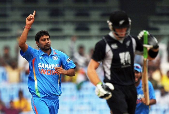 Praveen Kumar celebrates after taking the wicket of Martin Guptill during the final ODI match between India and New Zealand in Chennai. (AFP Photo)