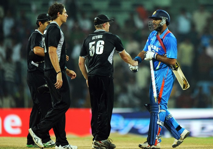 Scott Styris followed by his teammates congratulate Yuvraj Singh for winning the match against New Zealand during the final ODI between India and New Zealand at the M A Chidambarm Stadium in Chennai. Chasing a target of 104 runs to win India won the match by eight wickets and the five match ODI series 5-0. (AFP Photo)