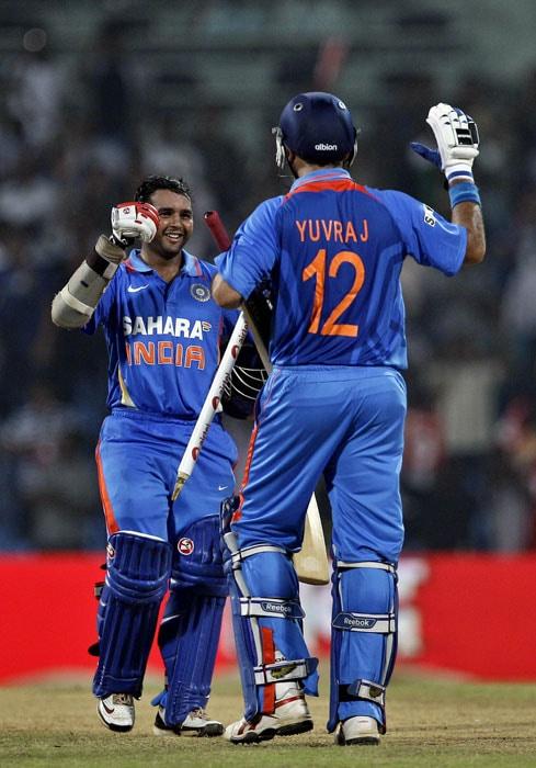Yuvraj Singh and Parthiv Patel celebrate their win over New Zealand in the last ODI in Chennai. (AP Photo)