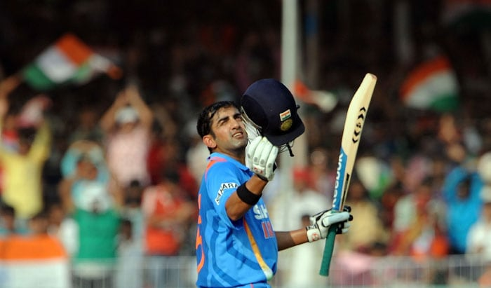 Gautam Gambhir reacts after reaching a century (100 runs) during the third ODI between India and New Zealand at the Reliance stadium in Vadodara. (AFP Photo)