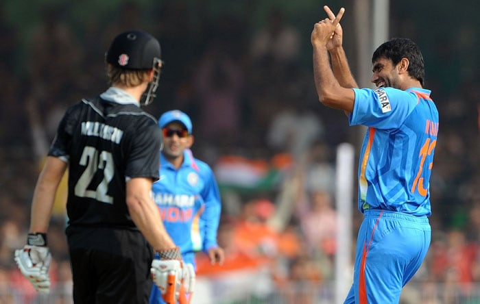 Munaf Patel celebrates after taking the wicket of Kane Williamson during the third ODI at the Reliance stadium in Vadodara. (AFP Photo)
