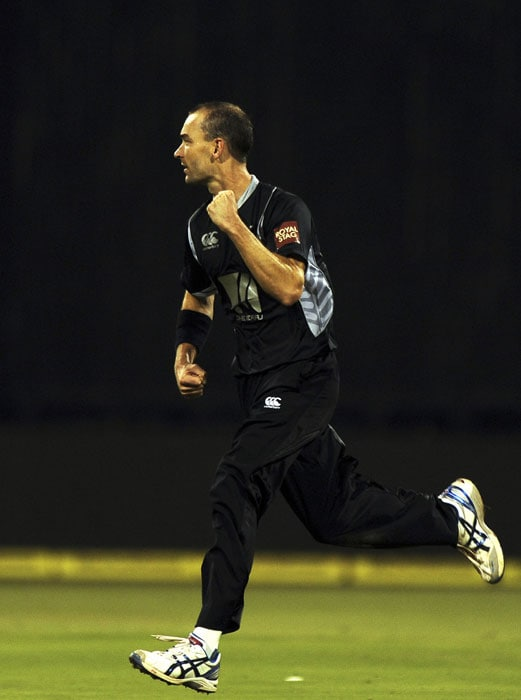 Andy Mckay celebrates the wicket of Gautam Gambhir during the fourth ODI between India and New Zealand in Bangalore. (AFP Photo)