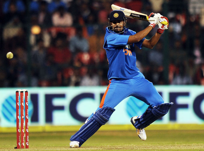 Yusuf Pathan plays a shot during the ODI between India and New Zealand in Bangalore. (AFP Photo)