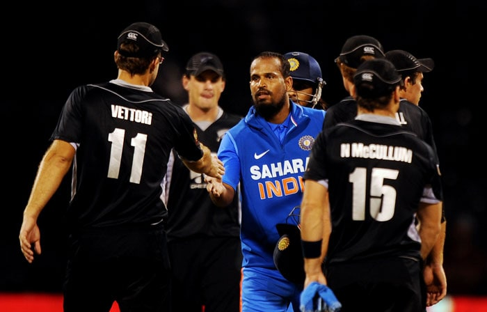 New Zealand captain Daniel Vettori and his teammates congratulate India's Yusuf Pathan for his match winning innings during the fourth ODI between India and New Zealand in Bangalore. Indian won the match by five wickets and lead the five match ODI series 4-0. (AFP Photo)