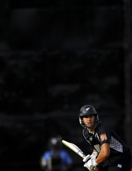 Ross Taylor plays a shot during the fourth One-Day International between India and New Zealand in Bangalore. (AFP Photo)