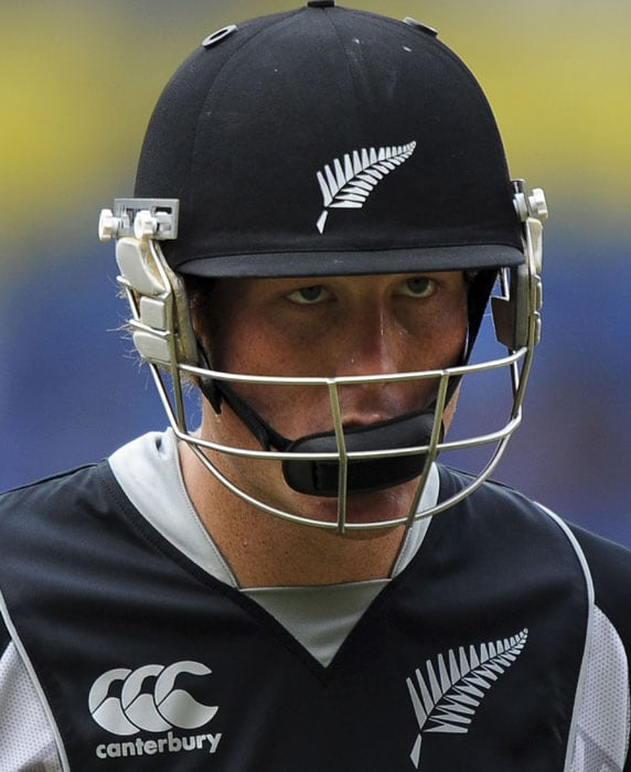 Martin Guptill walks to the pavilion following his dismissal during the fourth One-Day International match between India and New Zealand in Bangalore. (AFP Photo)