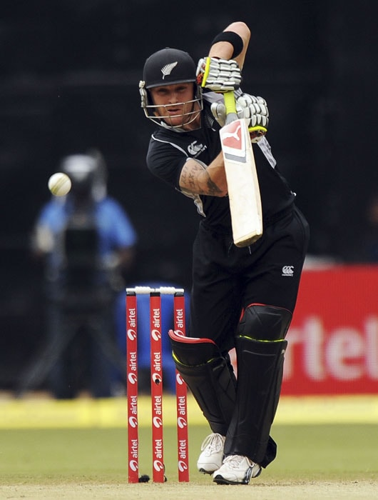 Brendon McCullum plays a shot during the fourth ODI match between India and New Zealand in Bangalore. (AFP Photo)