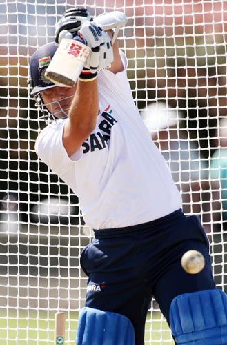 Sachin Tendulkar drives a ball in nets at Napier. India is preparing for their first one-day match against New Zealand to be played on March 3. (AFP Photo)