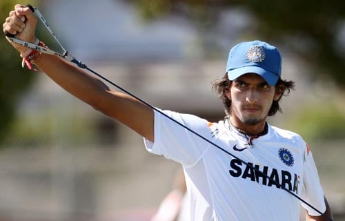 Ishant Sharma goes through his stretching exercises as he recovers from a shoulder injury, during training in Napier. (AFP Photo)
