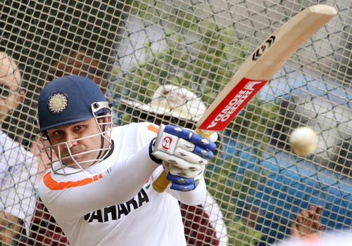 Virender Sehwag swings a ball away during training in Hamilton on March 10, 2009. India play New Zealand in the fourth one-day international on March 11 and lead the series 2-0 with one match washed out. (AFP Photo)